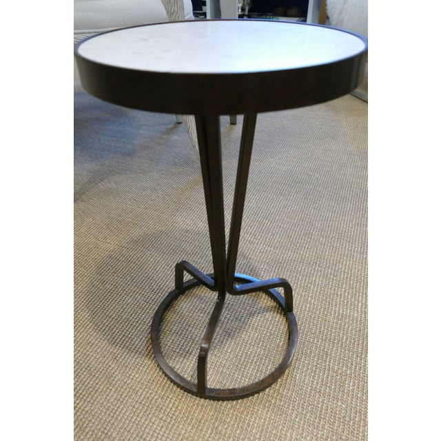 Hand-crafted wrought iron base drink table has a marble top and an open tripod base! This drink table is perfect next to...