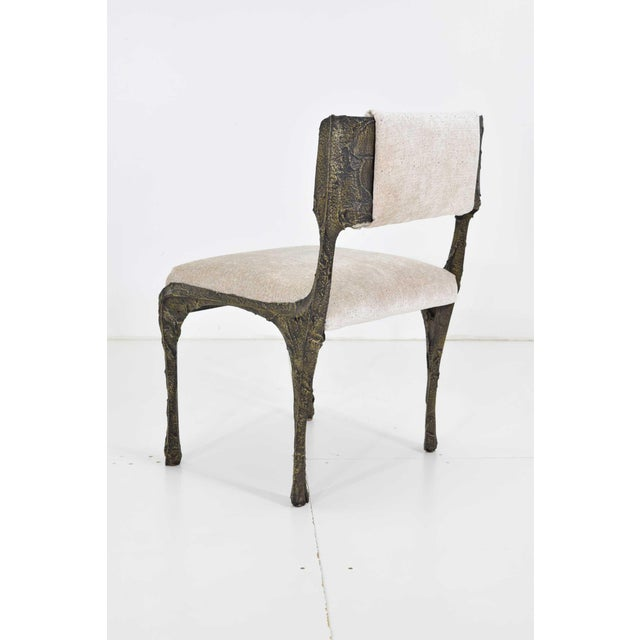This is a beautiful set of Paul Evans' Brutalist bronze and resin dining chairs. These were owned by one owner who...