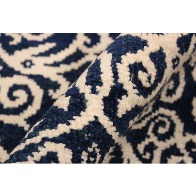A beautiful transitional pattern rug with a soothing dark blue on ivory silk combination is a great addition to any style...