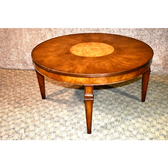 Vintage coffee table has a regency style. Made by Old Colony Furniture. Lazy Susan top. The wood is Fruitwood & Burl....