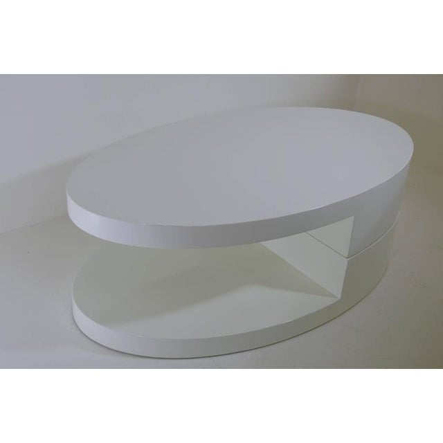 Amazing rotating coffee table lacquered in white, inspired by Gabriella Crespi.