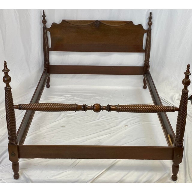 Beautiful full size mahogany four poster bed by Statton Furniture featuring carved leaf and swag motifs and carved spiral...