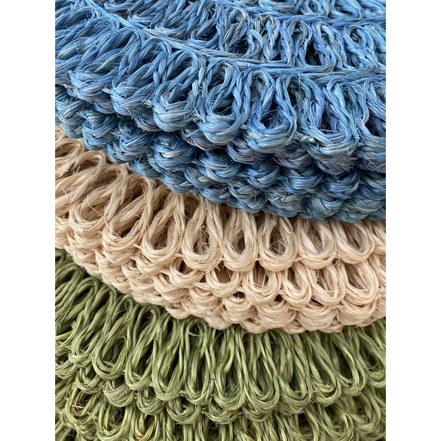 """Set of 8 round 15"""" woven abaca placemats in a loop design. Aqua in color."""