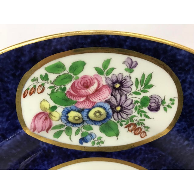 Set of 12 Crown Staffordshire 9 inch luncheon plates with white centers, cobalt rims adorned with handprinted flowers in...