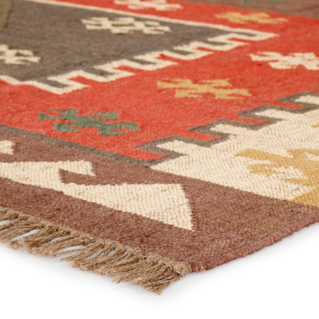 Rich tones and a captivating geometric design combine to create this Southwestern-style area rug. This flatweave jute...