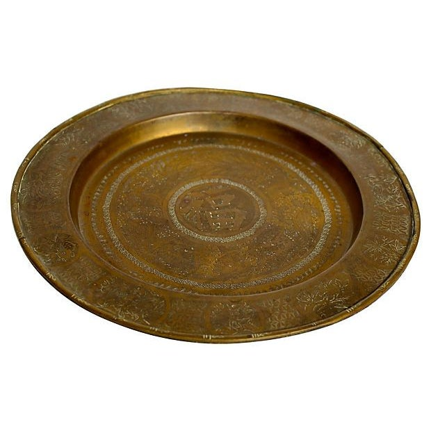 "Etched brass Chinese tray with a dragon motif around the Chinese symbol center. Bamboo-style rim. Marked ""China."""