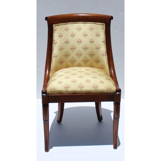 This stylish set of Charles X style mahogany wood dining chairs were acquired from a Palm Beach estate. The fabric is...