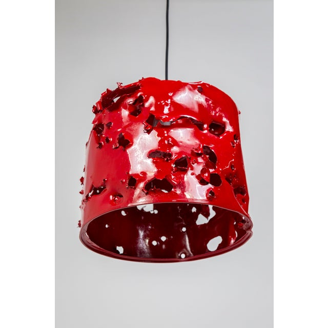 This powder coated, metal gas can is a bold art object by Charles Linder, who has been making artwork out of bullet-...
