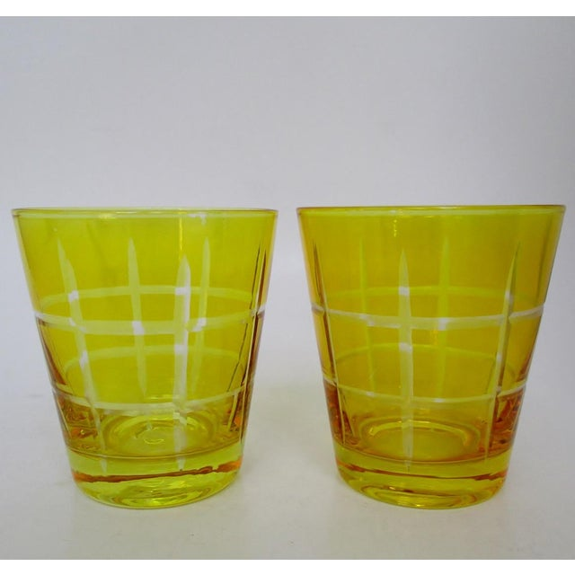 A pair of bright yellow glass double old fashioneds with hand-etched plaid pattern. No maker's marks. Slight shade...