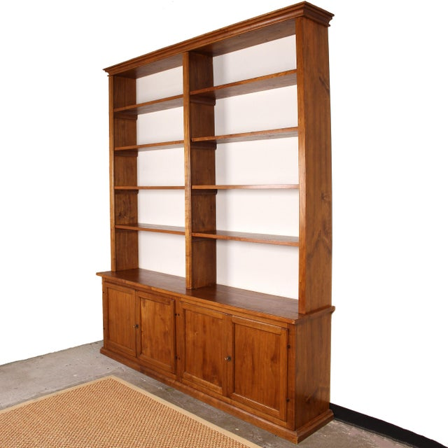This refined bookcase was handcrafted by artisans in Italy using old poplar wood that was salvaged from an archive in...