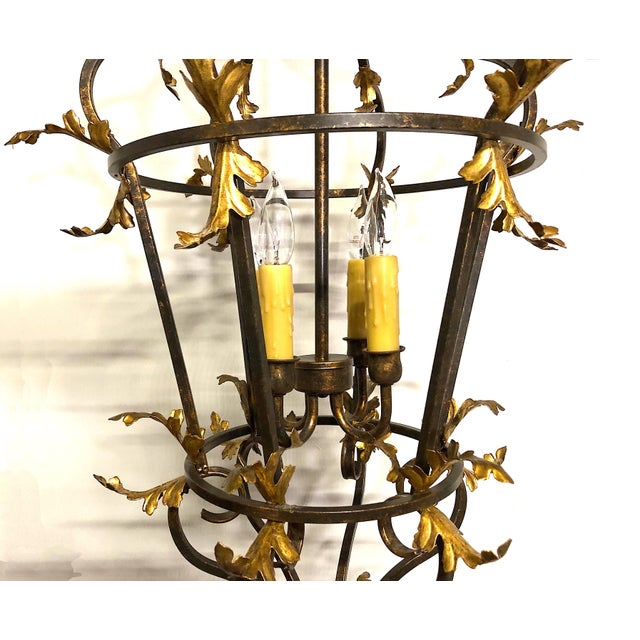 This foliate tour de force lantern is certain to make a statement in your entrance hall, dining room, or any soaring...