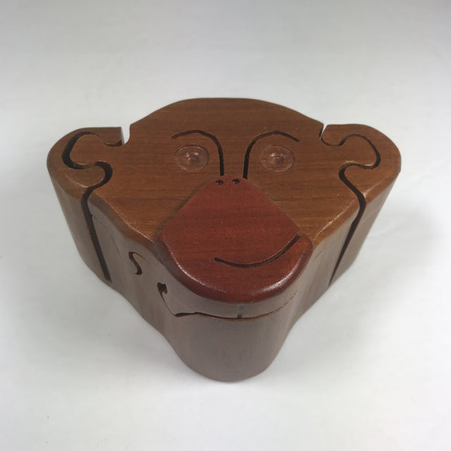 Monkey puzzle box. Monkey head that is a series of puzzle pieces that come apart to reveal a tiny hidden compartment....