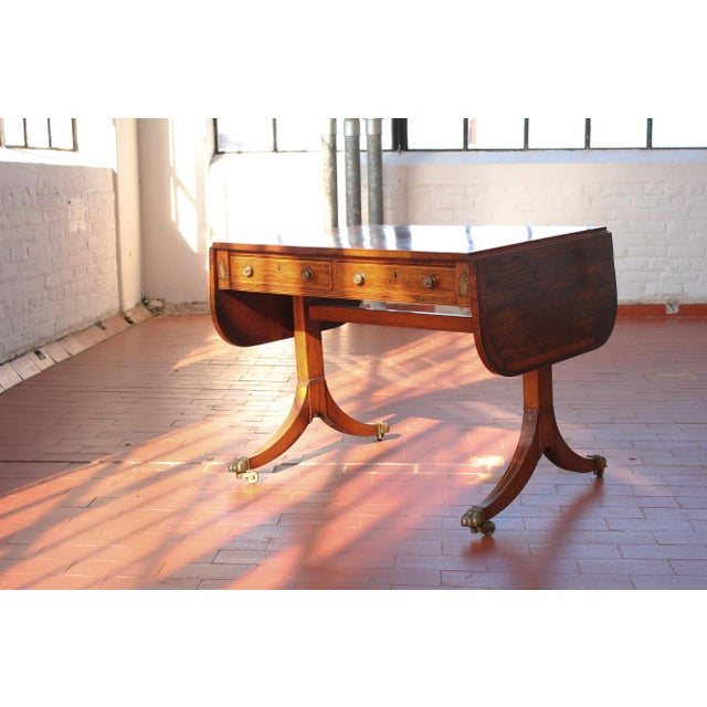 Old world grace, charm, and gravitas permeate this desk. The striking stripes and waves of the rosewood are on full...