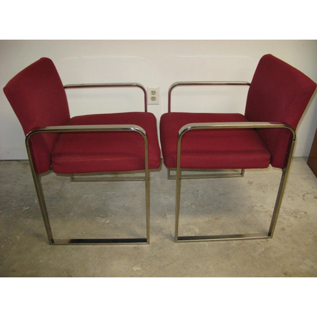 Great lines ! These vintage chairs show really well. Made by Crucible products corp. Not sure of the designer, nice job...