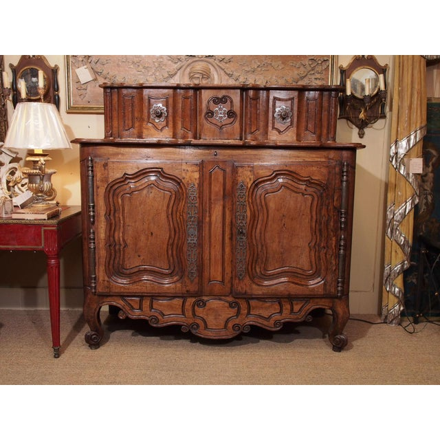 From Fourques ,Provence ,France , this 2 part buffet is entirely hand carved. Lower portion consists of 2 doors with 1...