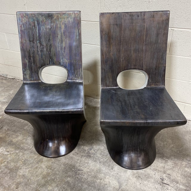 Great pair of fiberglass z shaped accent chairs. Unusual iridescent patina finish. Minor scratches that could be touched...
