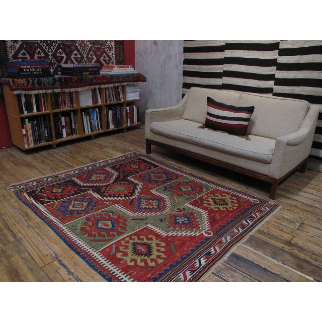 A beautiful example of Anatolian Kilim weaving tradition from West-Central Turkey, displaying a well-known design of...