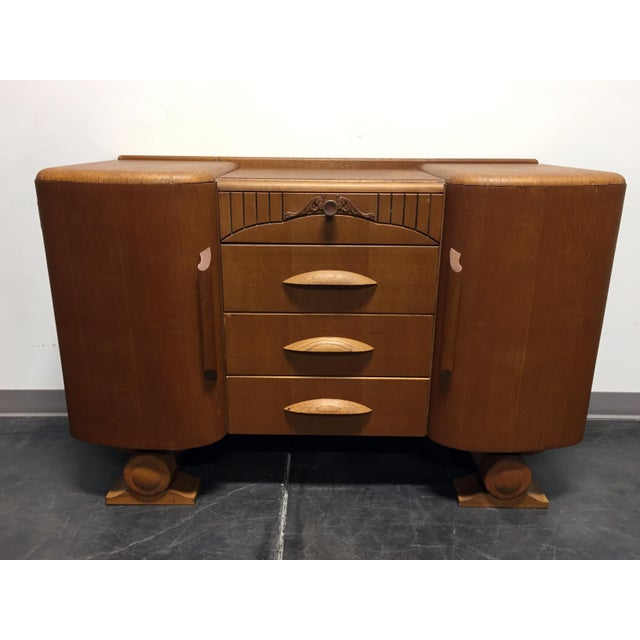 Vintage art deco style quatersawn tiger oak sideboard by Harris Lebus Furniture Company. Harris Lebus was a furniture...