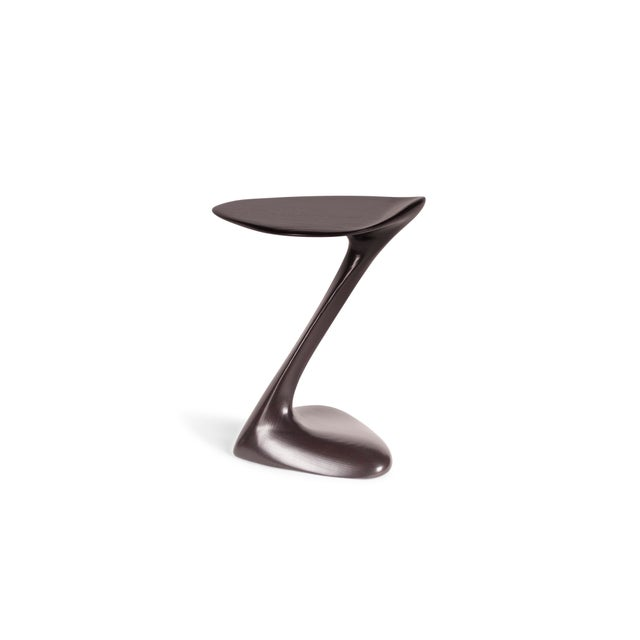 sculptural side table with unique and dynamic shaped designed and manufactured by Amorph. Stain color can be modified....