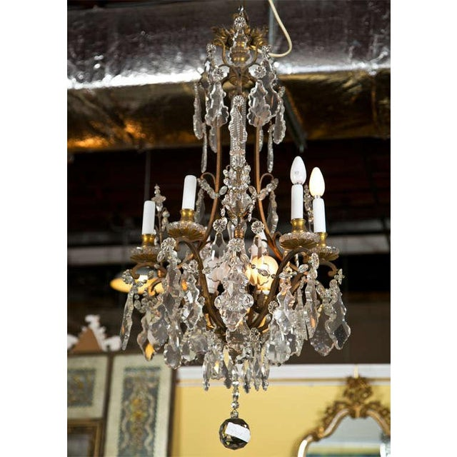 Late 19 or very early 20th century barley twist glass column center form bronze and hanging crystal chandelier. Six lights...