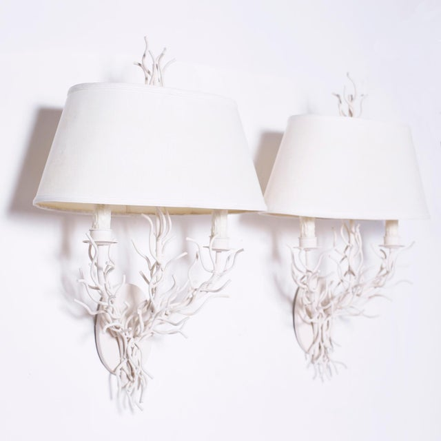 Chic midcentury sea inspired faux coral wall sconces created in iron and painted white with stylized finials and two...