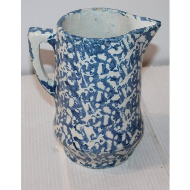 This sponge ware pitcher has a simple yet interesting shape. The condition is good with no cracks minor rim chip, does not...