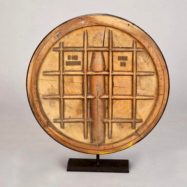Large 1940s English round wooden industrial mold with a grid pattern in relief mounted on a custom metal stand. Excellent...