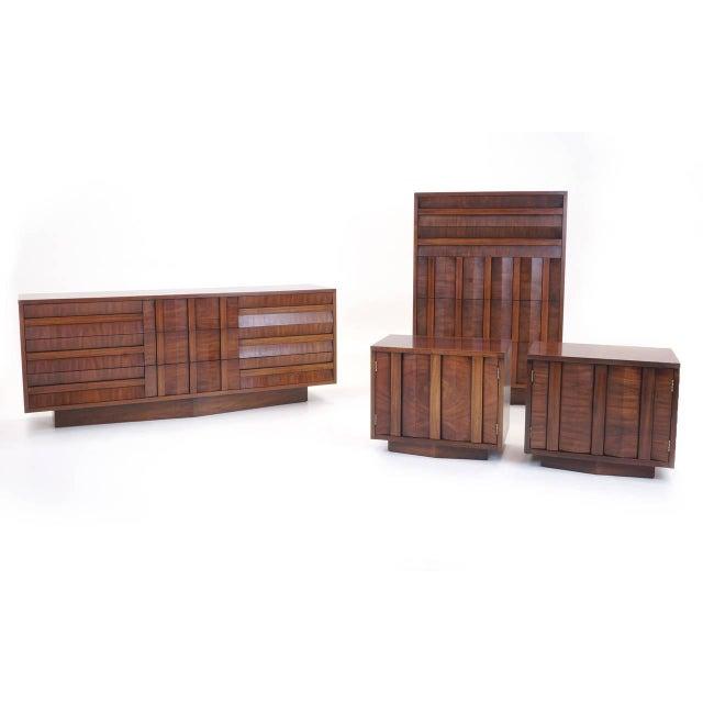 Lane sculptural/Brutalist nine-drawer walnut dresser. Notice the cool design of the base as well.