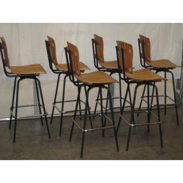 Set of six professionally restored Authur Umanoff bar stools. in excellent condition . The wood slat seats show all of...