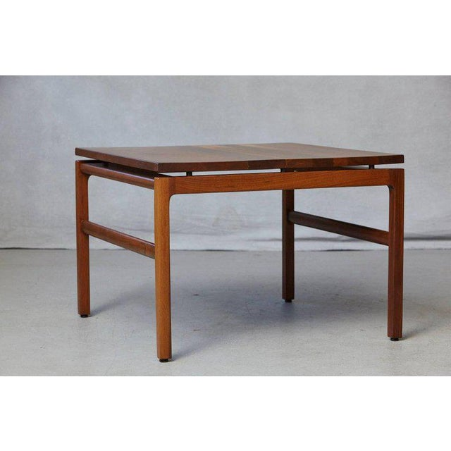 Gunlocke walnut side table, 1960s. The Gunlocke logo on the underside of the table. The table has been newly refinished in...