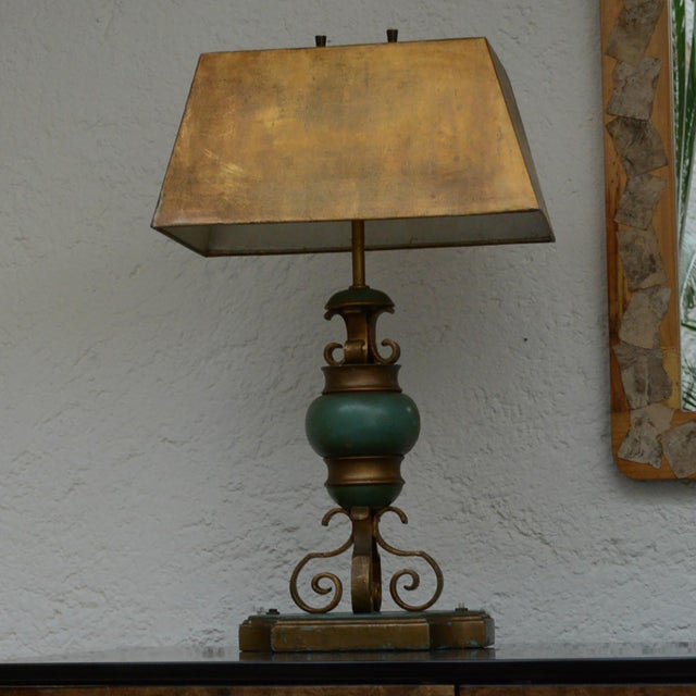 For your consideration a Mexican modernist table lamp in wood and gilt forge iron with original shade. Original vintage...