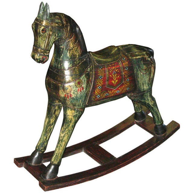 Vintage hand painted wood rocking horse made by artisans from Jaipur, India. Colorfully painted rocking horse was used by...