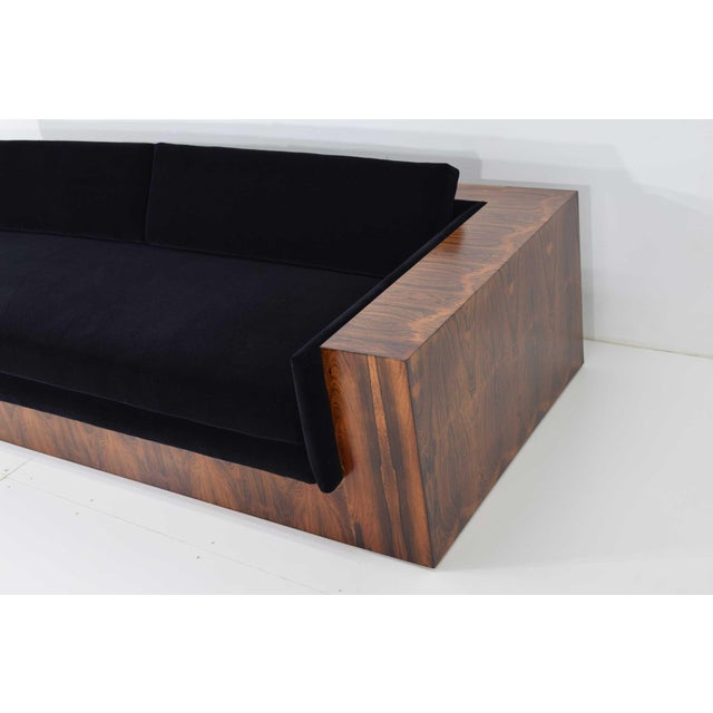 This sofa is hard to come by. And this one is beautiful. The graining is special. Large rosewood case sofa. We have...