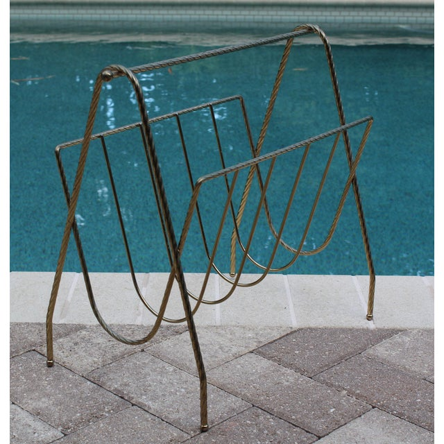 Vintage metal wired magazine rack This elegant rope motif wire magazine holder will work great in any modern decor...