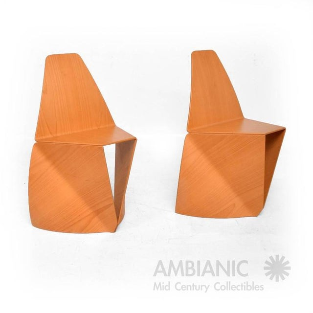 For your consideration a pair of stackable chair in bent plywood (birch/blond wood). The chairs have a unique modern...
