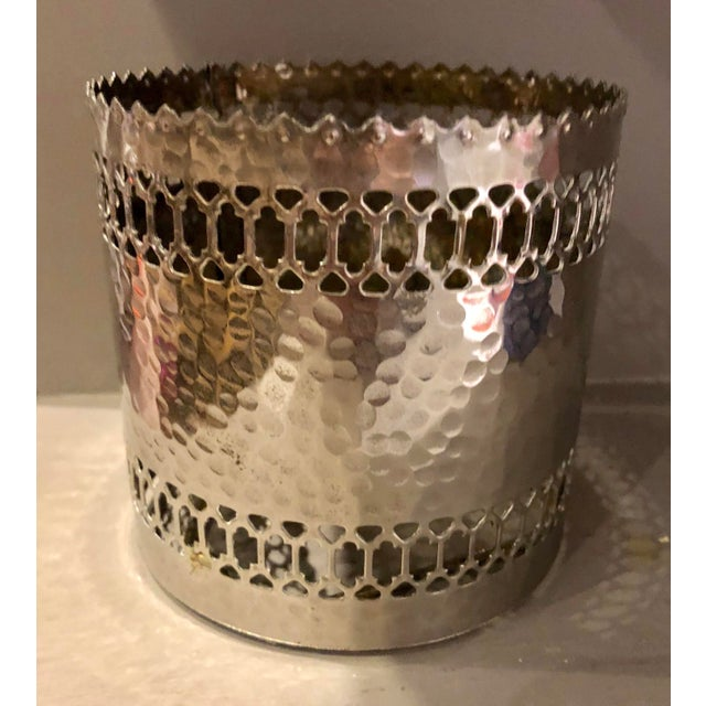 Silver plate pierced and scalloped design hammered bottle coaster. No maker's marks.