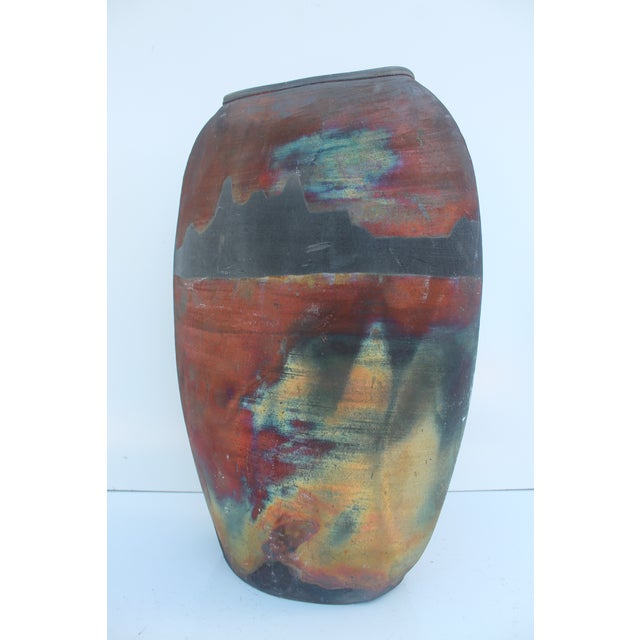 Offered is a vintage mid-century modern studio pottery vase. The vase is signed. Great abstract colors.