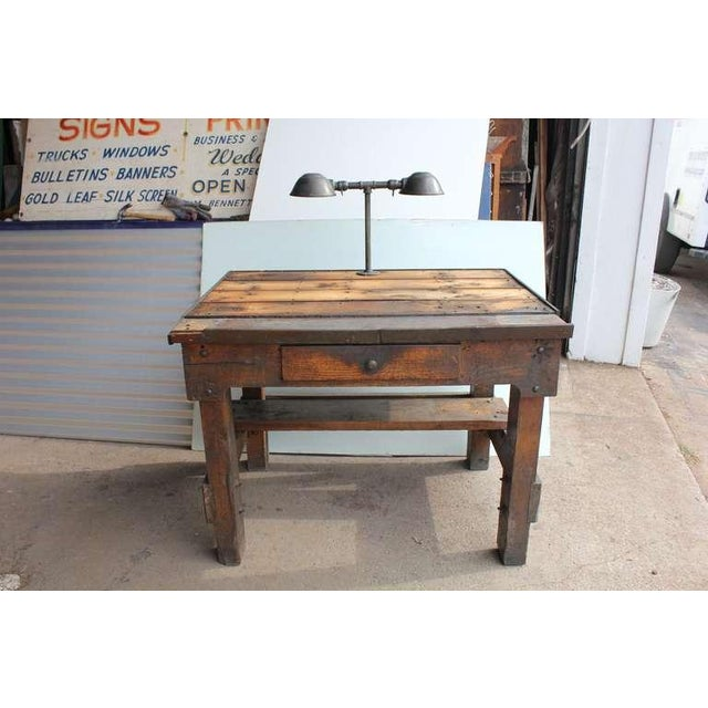 Antique original American oak industrial desk with original double lighting. We have two available.
