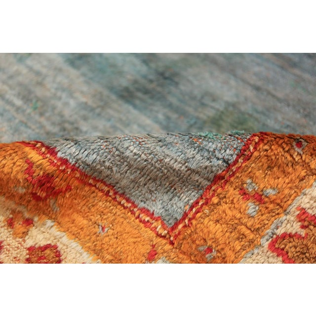 Breathtaking happy light blue colored open field design antique Turkish angora Oushak rug, Country of origin / Rug type:...
