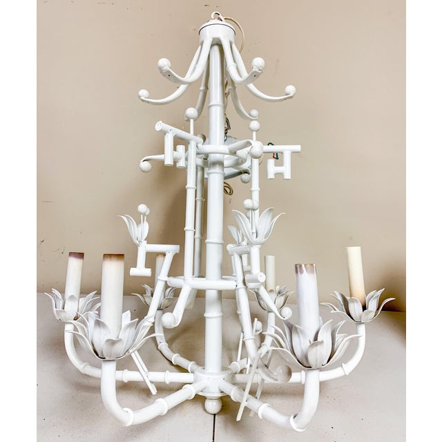 This is a 1970s white 6 arm chandelier with Chinese Chippendale styling. It is in working order. Each arm supports a 40...
