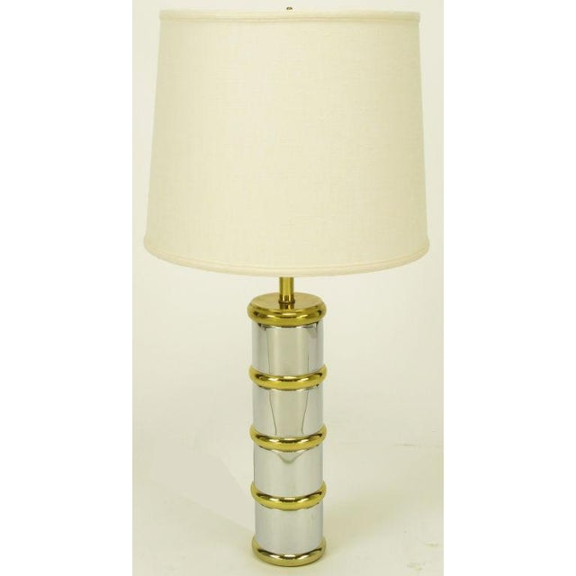Post modern table lamp with chrome column and brass rings, cap and stem. Similar to designs by Laurel Lamp.