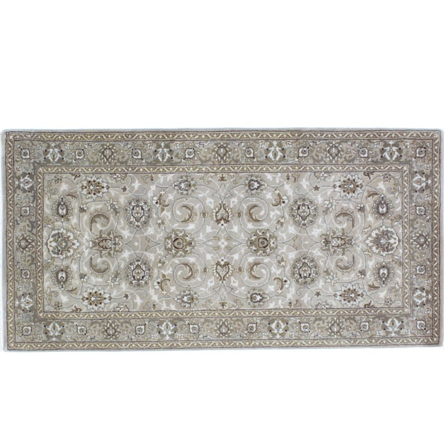 Wool pile Persian Tabriz Style rug hand woven in India.