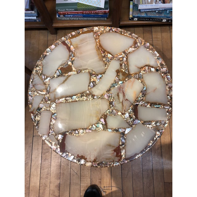 Rare and near perfect Arturo Pani side table. Gorgeous chunks of onyx, abalone and gold chips! A definite 'add' to your...