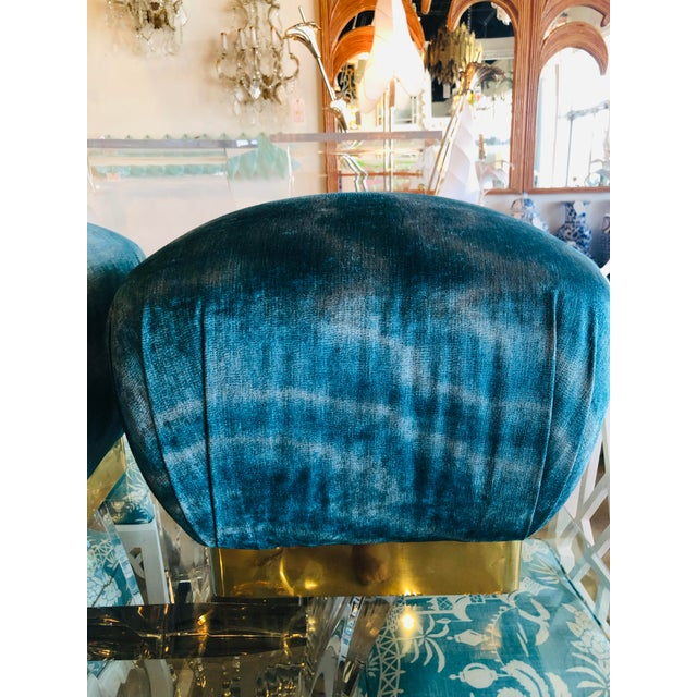 Amazing pair of vintage poufs. Original brass base has been polished. There are slight indents in some areas. Newly...