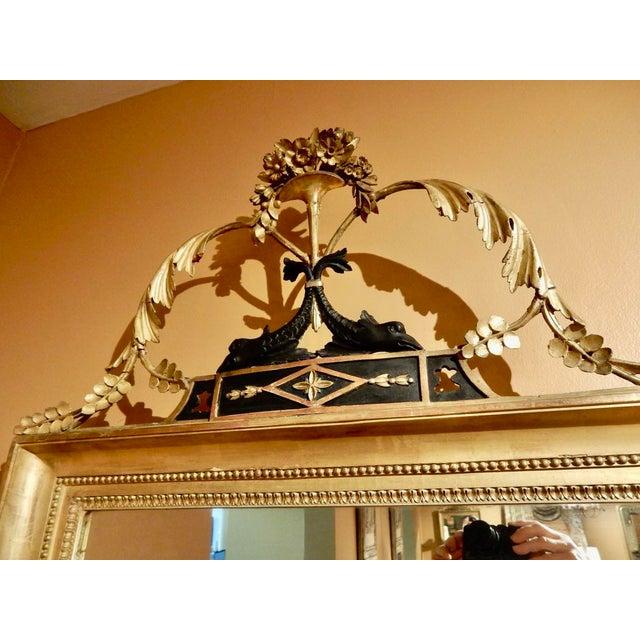 Elegant 19-Century Neo-Classical gold gilt wall mirror. The mirror has Northern European origins, Sweden or England . The...