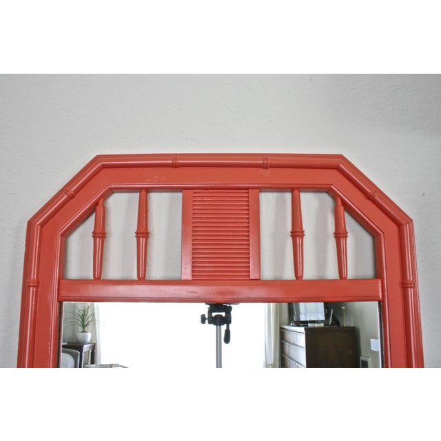 Hollywood Regency faux bamboo mirror painted in a bright glossy coral. A great Palm Springs style mirror for your...