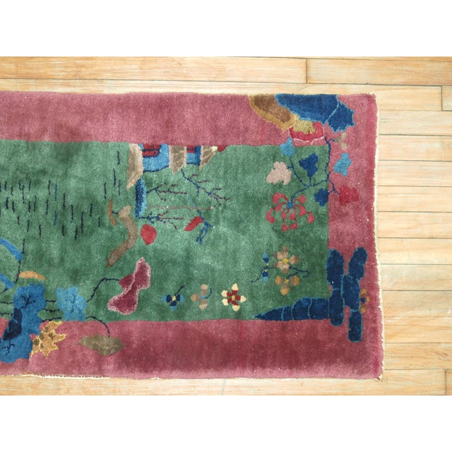 A hand-knotted Jewel Toned Vintage Chinese Art Deco Rug from the middle of the 20th Century