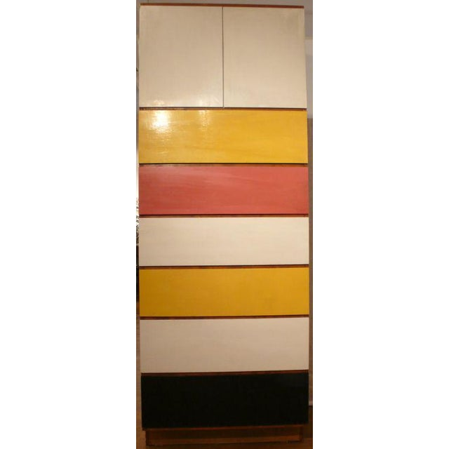 Tall cabinet of solid and painted wood, with six drawers and two doors, by renowned architect and landscape designer Dan...