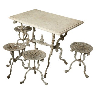 Suite of Grey Painted Cast Iron Table and Four Tabourets For Sale