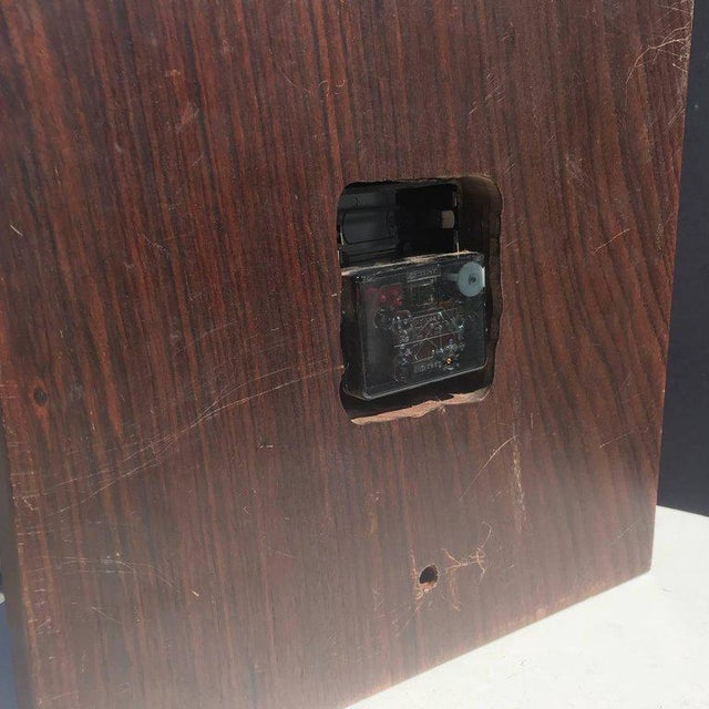 For your consideration, a Mid-Century Modern wall rosewood and brass clock.